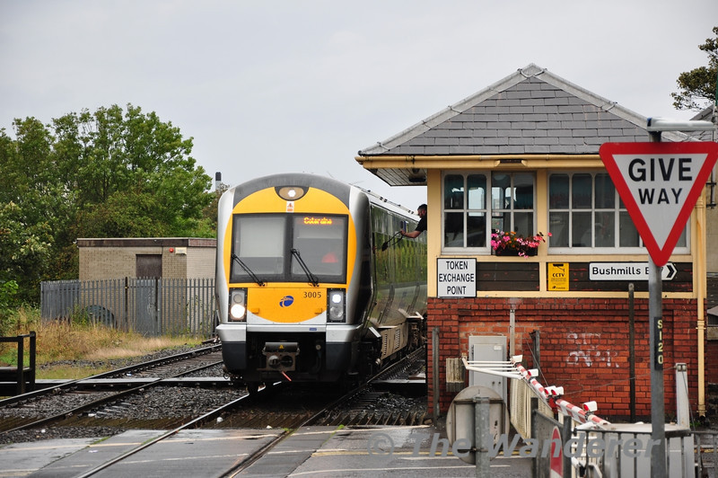 The driver of the 1350 Portrush - Coleraine hands back the token to the Coleraine Signalman.