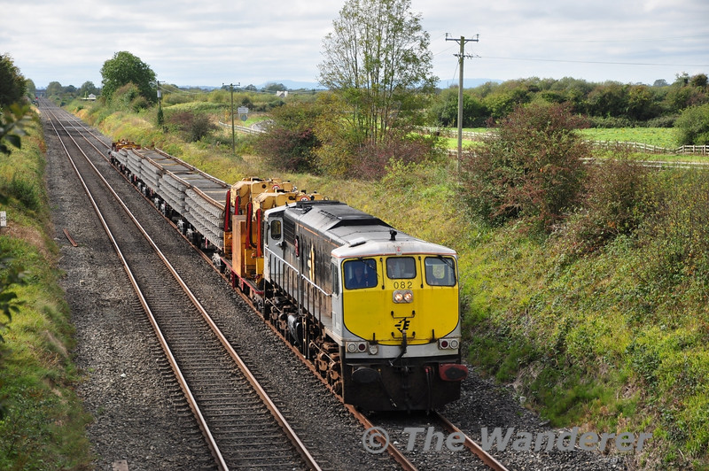 082 worked a 1155 Limerick Jct - Portlaoise Per Way Yard Relay train with redundant track panels. It is seen at Clonkeen, south of Laois Train Care Depot. Tues 27.09.11