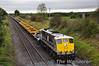 A colourful and long (16 bogies) per way train operated from Limerick Wagon Works to Portlaoise Per Way Yard. The train consisted of one single bogie flat, five of the new spoil wagons which will replace the Barytes wagons currently in use. Bringing up the rear was 10 wagons used on the steel train which is used to bring imported rails from Belview Port to Portlaoise. 075 is pictured at Clonkeen near journeys end. Tues 27.09.11