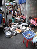Washing the dishes in the street !