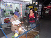 Toni buys a platter of insects from a street vendor to try !