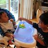 caleb loves feeding micah!