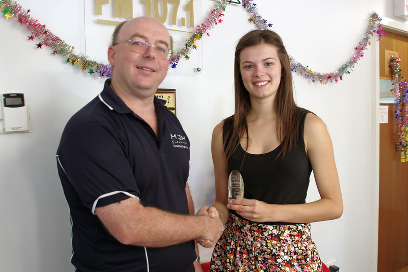 Paige being presented with her award by 2AAA chairman, Michael McFeeters