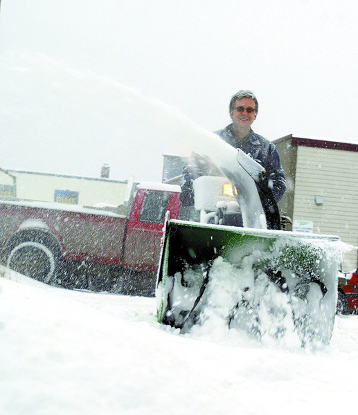 Dennis Breck clears the parking lot at Moore Appliance Tuesday morning.  Citizen photo by Brent Braaten