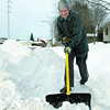 Mary Baker clears the sidewalk near her home on Ospika Blvd Thursday afternoon.  Citizen photo by Brent Braaten