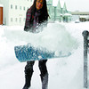 Ochie Uy had to quickly move the snow from the sidewalk Sunday morning in front of the Kelly O'Bryan's restaurant to make way for customers. Citizen photo by David Mah