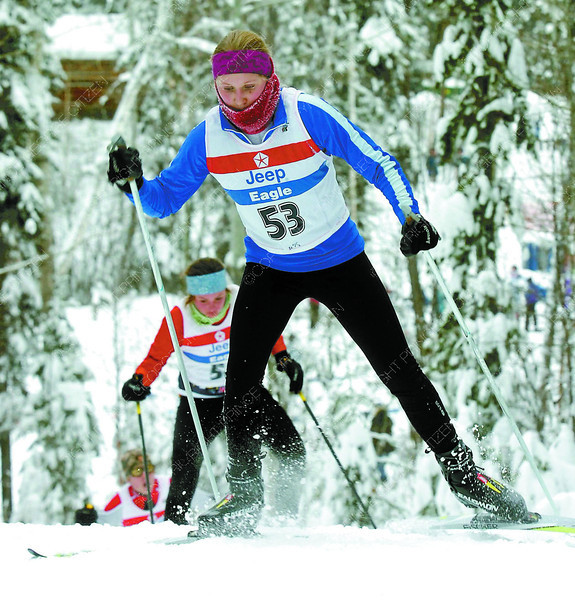 (PG 101) PRINCE GEORGE, Jan 15 ***--BC Cup #1 cross country ski--Samantha Unger, is chased by Emalee Vandermale, in the juvenile girls class, as Judah Bucher, in the juvenile boys class catches up in the 3.5 km freestyle race in the 2011 BC Cup #1 Cross country race Saturday at the Otway Nordic Ski Centre in Prince George. Temperture for the race was minus 19 C.(CP PHOTO) 2011 (PRINCE GEORGE CITIZEN--DAVID MAH)