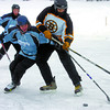 Kristan Bragg, left, of Shooters Bar and Grill, and Jas Brar, of the Black Aces jostle for the puck Saturday during the 1st annual Northern Regional Pond Hockey Championships at West lake. Citizen photo by David Mah
