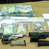Citizen photo by Chuck Nisbett Jewelry appraised at approximately $200,000, over $40,000 in cash and weapons seized by PG RCMP Task Force members during a six month investigation into a high ranking member of the Game Tight Soldiers.