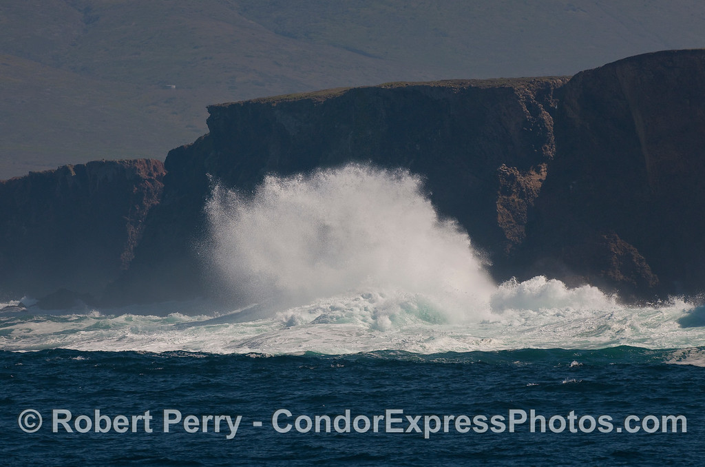 The rolling swells crash against the rocky shore at Frasier Point, Santa Cruz Island.  Image 2 of 2.