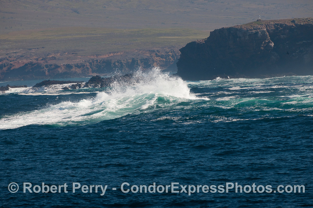 The rolling swells crash against the rocky shore at Frasier Point, Santa Cruz Island.  Image 1 of 2.