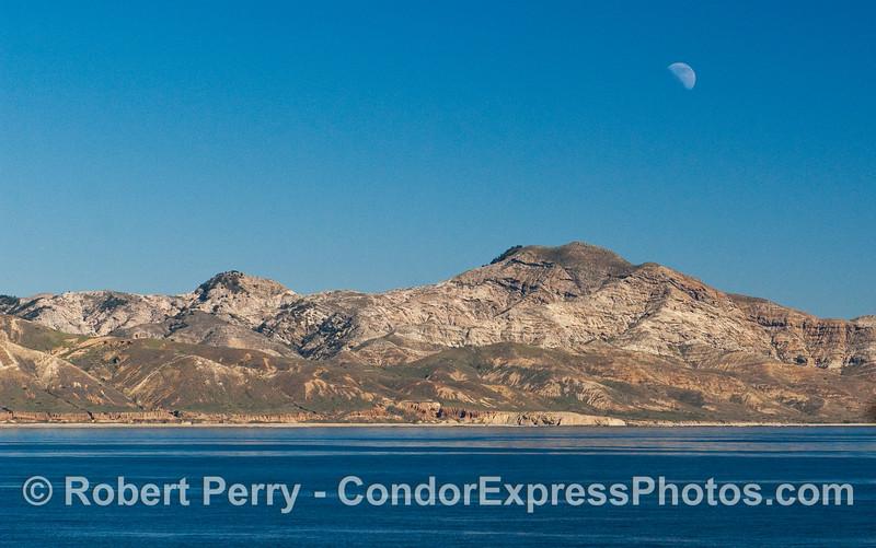 The moon hanging over the southwestern corner of Santa Cruz Island.