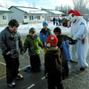Bonhomme learns a jig with students from Cedars Christian school Wednesday afternoon during their Winter Carnival. The students were curling, playing hockey, having snowshoe races enjoying warm drinks celebrating winter. The scholl has been having the carnival for over 20 years.  Citizen photo by Brent Braaten  Jan 3 2011