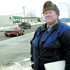 Const. Madonna Saunderson checks for seatbelt use and cell phone use along Massey Drive Wednesday morning.  Citizen photo by Brent Braaten  Feb 2 2011
