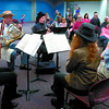 Prince George Symphony members Lynn Giesbrecht, left, on basson, Laszlo Klein, on french horn, Simon Cole, on clarinet, Erica Skowron, on oboe, and Don Bond, on flute, played Dr. Seuss's 500 Hats of Bartholomew Cubbins, Saturday at the Prince George Public Library. Citizen photo by David Mah
