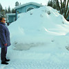 Fern Hollahan is amazed at the size of the snow pile in front of her mobile home in the Inverness Park after Monday's dump. Feb 07 2011 Citizen photo by David Mah
