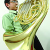 Keshav Mann warms up with his french horn prior to playing in the Concert Group French Horn Wednesday morning at Our Saviour's Luthern Church in the 60th Annual Prince George and District Music Festival. The festival's Showcase Recital will be at 5:30pm  and the Festival Gala will be at 8 pm this Sunday at the Prince George Playhouse. Citizen photo by Brent Braaten  March 09 2011