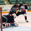 Prince George Cougars Joshua Smith looks for a rebound in front of Rockets goalie Adam Brown while being checked by Shane McColgan during  fourth playoff gasme in the first round series between the Prince George Cougars and Kelowna Rockets Wednesday night at CN Centre. Citizen photo by Brent Braaten