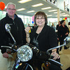 Winner of the Vespa in the Citizen/Wood Wheaton Thanks a Million promotion was Elaine McInnes. Greg Nikkel from NR Motors who supplied the vespa with Elaine McInnes as she sits on it with the keys in her hand. Citizen photo by Brent Braaten