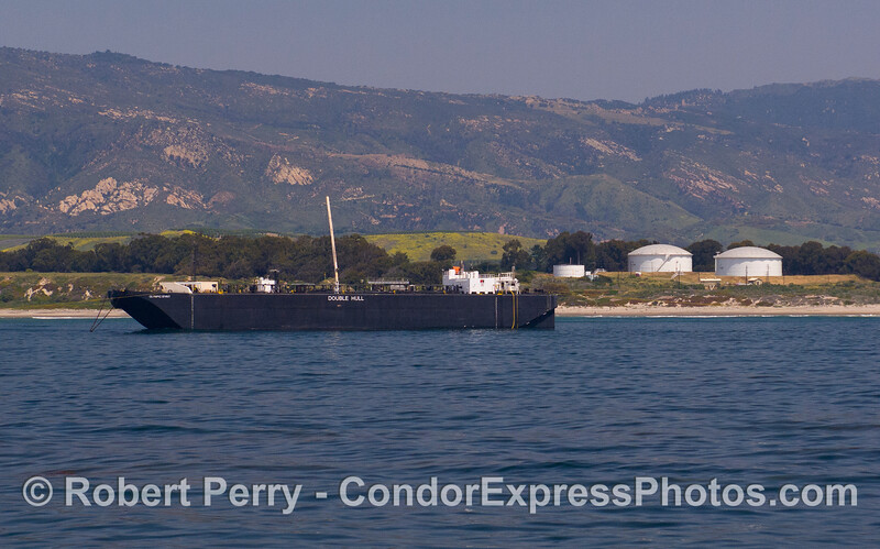 """The oil barge """"Olympic Spirit"""" at the Elwood Oil tanks."""
