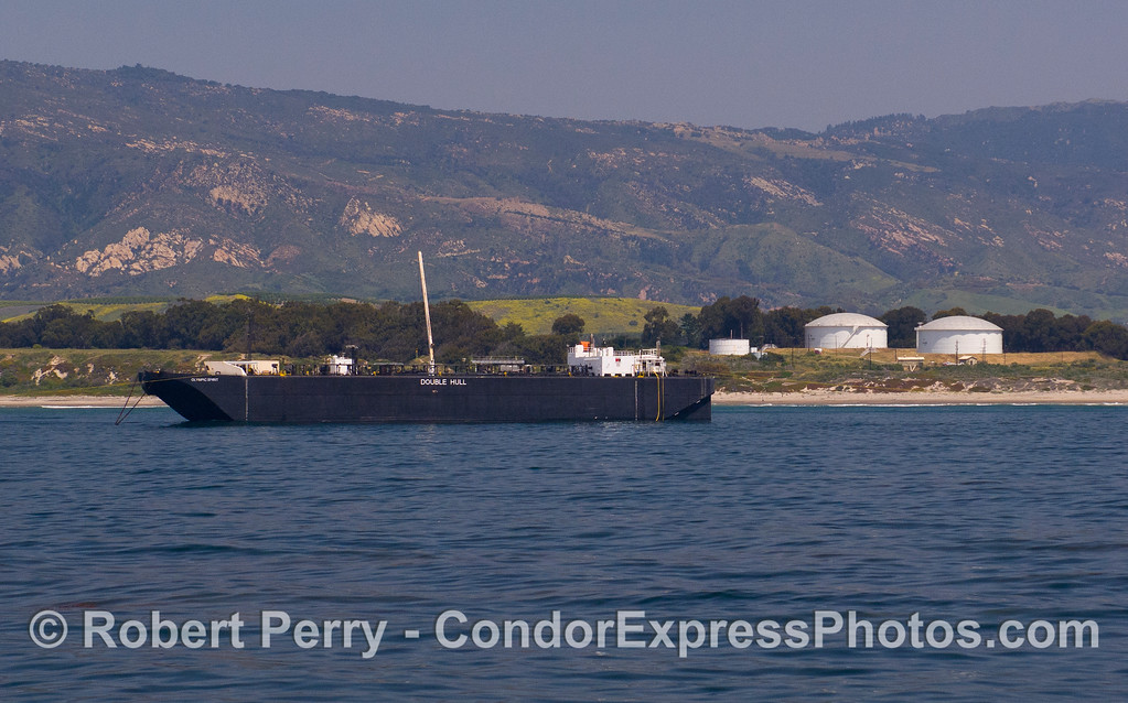 "The oil barge ""Olympic Spirit"" at the Elwood Oil tanks."