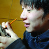 Yuki Ishio, 17, a Japanese exchange student visiting from Daito Bunka Daiichi high school in Tokyo Japan, draws the art work on a native rattle he made at College Heights Secondary school Monday morning. A group of 14 students and two teachers have been here for the last two weeks and a group from College Heights will be headed to Japan in June to complete the exchange. Some of the highlights for the Japanese students were going to a Cougars Hockey game, visiting Mr. PG, completing a scavenger hunt through Prince George and going skating.  Citizen photo by Brent Braaten