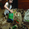 Annie Lewis, 9, a Grade 4 student at Sacred Heart School organizes a collection of brown bag lunches made at home by school families and staff for the St. Vincent de Paul Drop-in-Centre. The school collected over 70 lunches this year. Citizen photo by Brent Braaten April 19 2011