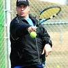 Rob Crobar returns a serve during a tennis match Friday at the Prince George Tennis Club. Crobar along with Les Obst, Jim Condon and Phil Redding were getting in a game of doubles. Citizen photo by Brent Braaten         April 22 2011