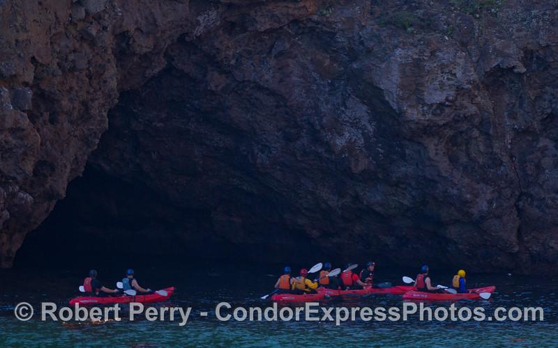 Kayaks near a cave.