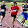 Sam Goodrich, left, Austin Bartell, and Chris Rzyczycki, round the first corner in the boys 1500m race Saturday in the Sub Zero Track Meet at Masich Place Stadium. Citizen photo by David Mah May 2 2011