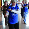 Cecile Duffy and others from the Elder Citizens Recreation Association take part in the Tai Chi arthritis workout at the Exploration Place. Citizen photo by David Mah May 2 2011