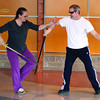 Anna Michael and Jim Cryderman put on a sword demonstration during World Tai Chi Day at the Exploration Place Saturday. Over 40 people participated in the event. Citizen photo by David Mah May 2 2011