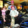 Rozalynn Reece, 2, her brother Pryce, 3, and their dad Reece, checked out Arnold Boomhower's 2007 Honda Goldwing at the Motorcycle Show and Shine at the Pine Centre Saturday. This motorcycle was part of the GoldWing Road Riders Association booth. Citizen photo by David Mah May 2 2011