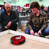 Neil Pawluk, left, shows Sam Isabelle, the iBot Robotic Vacuum at the Canadian Home Builders Association of BC Home Show. The Kin Centres were filled with vendors offerring all types all home-related items. Citizen photo by David Mah May 2 2011