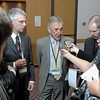 Rolf Fyne, centre, along with Avrom Salsberg, both Trade Investment Representatives,  speak to media during a break at International Trade Investment Representative Mission to Northern BC at the Ramada Monday morning. Citizen photo by Brent Braaten   May 30 2011