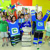 Monica Berra's Grade 2 class at Pinewood School show off their Canuck spirit in preperation to the opening game in the Stanley Cup finals. Holding the cup they made is Brayden Yeatman, centre, wearing the Flat Stanley costumes are Jaden Ngryen, 8, left and Bradley Jickels, 7, right. The class also sent photos of themselves in the costumes to the Canucks to give them some luck. Citizen photo by Brent Braaten           May 31 2011
