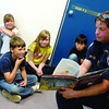 City of Prince George fire fighter Ryan Waddington reads to students at Vazn Bien School Wednesday morning during the schools book crawl. Guest readers included R.C.M.P. members, BC Ambulance Paramedics, Staff from the School Board office, Rotarians, school bus drivers all together there was 18 readers for the event. Citizen photo by Brent Braaten      June 15 2011
