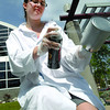Maddy Harder, Regional Program Coordinator for Two Rivers Gallery, sprays cans white in preperation for BMO KidzArt Dayz July 8 and 9. Two fun-filled days of art making activities for the whole family. Citizen photo by Brent Braaten             June 23 2011