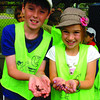 Kyle McKee, 9, left, and Emmanuelle Jacob, 7, show off earthworms from the vermicomposter at REAPS. The francais Le Cercle Des Canadiens summer camp kids were visiting the facility at Fort George Park Thursday.  July 8 2011 Citizen photo by David Mah