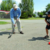 Caleb Emon, 6, gets ready to take a shot on his Papa (grand father) Wayne Brooks as the two take advantage of some sunshine to play some road hockey in the driveway on Loyola Drive Tuesday afternoon. Citizen photo by Brent Braaten      July 12 2011