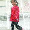 Finola Hanlon, 5, wears her rain coat in the Civic Centre Plaza fountain Monday. She was on a lunch break from the Two Rivers Art Gallery Creative Camp. Citizen photo by Brent Braaten       July 18 2011