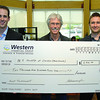 Jesse Ronahan, left, and Brett Nicholson, right with Western Finacial present Louis Kutin Chapter Chair the MS Society (Prince George) with a cheque for $2,941 the money was raised at the Western Finacial annual golf tournament fundraiser. Citizen photo by Brent Braaten         July 11 2011