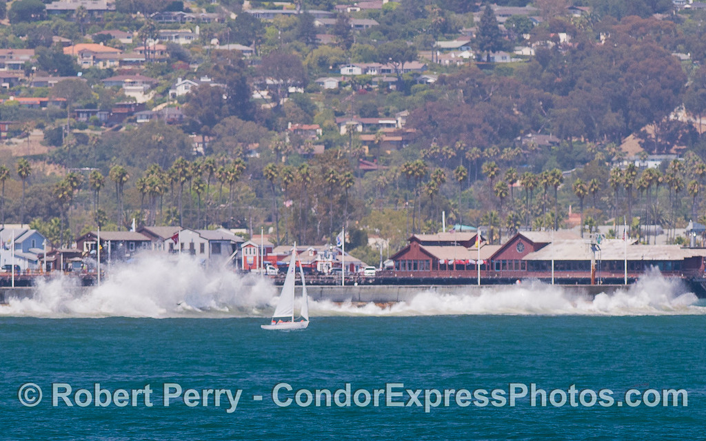 Swells crash against the Santa Barbara Harbor breakwater.
