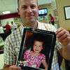 Scott Smith holds up the picture of his daughter Brenn Smith, 6,. Brenn had over 12  blood transfusion during her battle with cancer. Citizen photo by Brent Braaten      Aug 3 2011