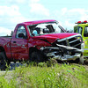 Tow truck operators load up a truck involved in an accident with a car on Highway 97 North near Nordic Drive Wednesday afternoon. Citizen photo by Brent Braaten         Aug 3 2011