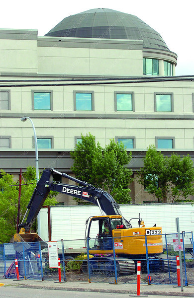 The Prince George Law Courts as the backdrop for an IDL excuvator working on the empty lot at the corner of George Street and Second Avenue. Citizen photo by Brent Braaten      July 26 2011