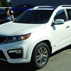 Cindy Melville from Gustafson's Kia and the 2012 Kia Sorento SX V6 awd. Citizen photo by Brent Braaten    Aug 23 2011