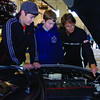 Chance Morrow, left, 13, and Tyler Riding, 13, look over the engine of Hazel Morris's 1999 Corvette Roadster during the Corvettes North judging and Show and Shine Saturday at Wood Wheaton. Aug 1 2011 Citizen photo by David Mah