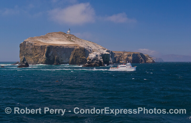 The vessel 'Vanguard' rounds East Anacapa Island on a sunny Fall day.