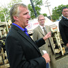 Mayor Dan Rogers along with Coucilor Garth Frizzell, Councilor Shari Green (behind mayor) and transportation manager Mick Jones annouce more paving projects this year along with projects for next year at the corner of Massey Drive and Ospika Boulavard Wednesday morning. Citizen photo by Brent Braaten  Aug 31 2011